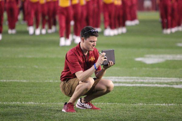 Student Kneeling on Football Field