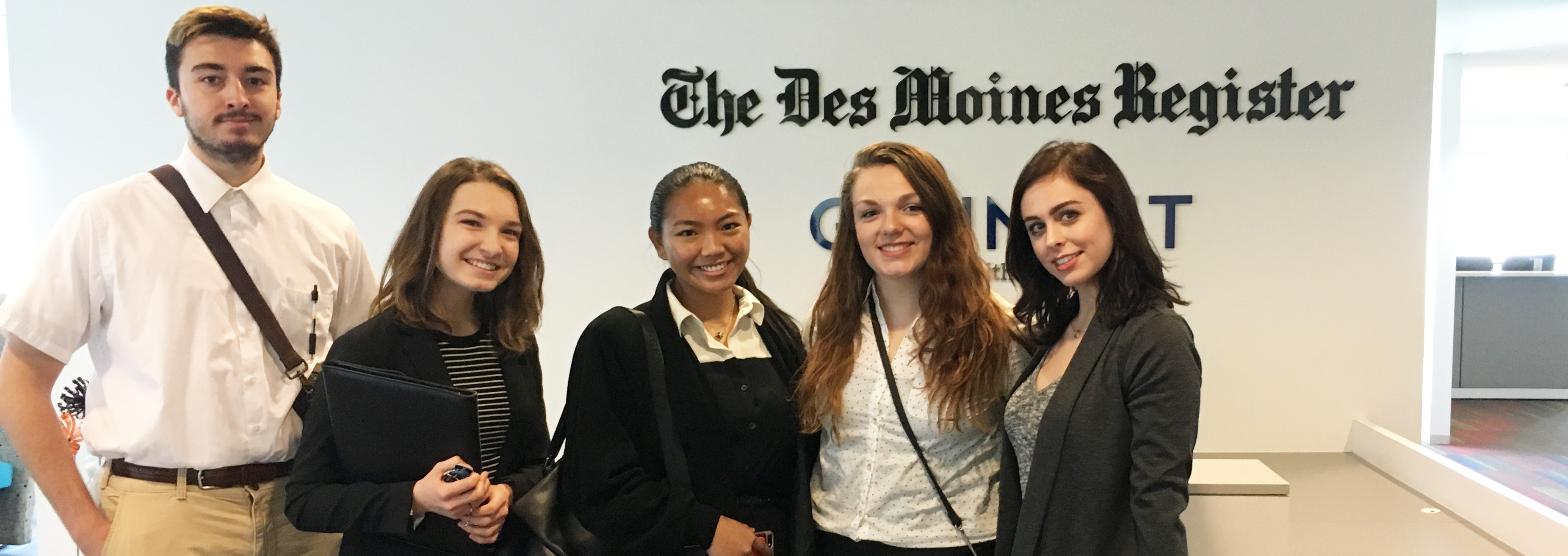 five members of Journalism Learning Community in the Des Moines Register newsroom