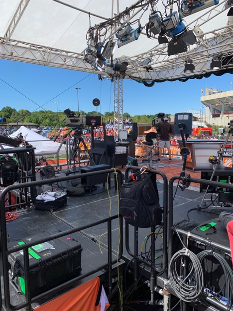 The College GameDay set with lights, cords, and other stage elements.