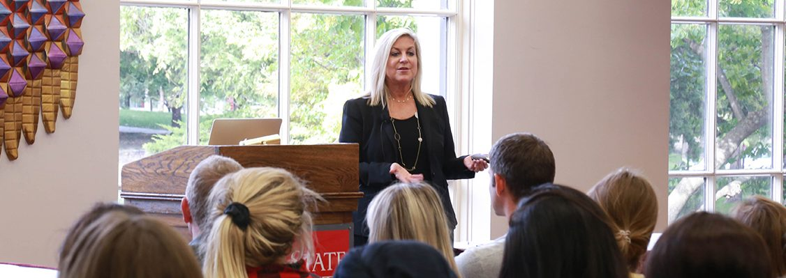 Kim Guthrie presents in front of a group of students at the Memorial Union.